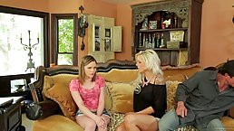 Nina Elle and Brianna Brown are licking one huge dick, while kneeling in front of a guy